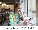 woman in the cafe with a phone | Shutterstock . vector #290972906