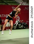 Small photo of Meghann Shaughnessy serving in the doubles vs Kirilenko/Hingis at Qatar Total Open, March 2, 2007.