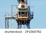 Dockside Crane With Worker In...