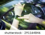 a woman uses smartwatch in the... | Shutterstock . vector #291164846