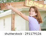 Young girl painting a lemonade stand sign - stock photo