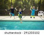 cute young boys jumping into a... | Shutterstock . vector #291203102