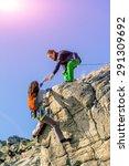 Climbers Teamwork. Two Climber...
