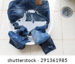 jeans in water bucket on... | Shutterstock . vector #291361985