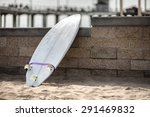 White Surfboard Leaning On The...