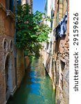 Small venetian canal in summer, Venice - stock photo