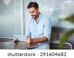 smiling businessman using a... | Shutterstock . vector #291604682