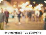 people walking on street in... | Shutterstock . vector #291659546