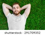 young man lying on the grass in ... | Shutterstock . vector #291709352