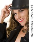 Blonde Fashion Model in Bowler Hat and Men's Raincoat. - stock photo