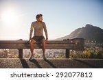 male runner sitting on a...   Shutterstock . vector #292077812