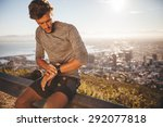 young man adjusting his gps... | Shutterstock . vector #292077818