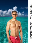 man on tropical maldivian beach.... | Shutterstock . vector #292139282