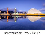 Kobe, Japan skyline with puddle reflections. - stock photo