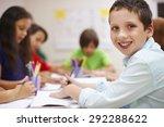 schoolboy doing his homework in ... | Shutterstock . vector #292288622