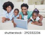 happy family lying on the floor ... | Shutterstock . vector #292332236
