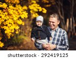 active grandfather holding his... | Shutterstock . vector #292419125