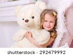 little cute girl embracing big... | Shutterstock . vector #292479992