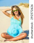 young woman on the beach with... | Shutterstock . vector #292572626