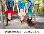 three girls hanging upside down ... | Shutterstock . vector #292578578