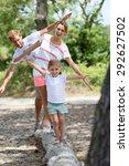 family having fun walking on a... | Shutterstock . vector #292627502