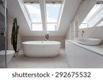 Porcelain freestanding bath in designed white bathroom - stock photo