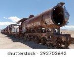 Old rusty locomotive with open steam boiler.Uyuni, train cemetery, Bolivia. Blue sky background - stock photo