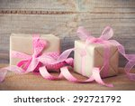 gift with pink ribbon and band... | Shutterstock . vector #292721792