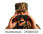 The soldier looks in the field-glass afar - stock photo
