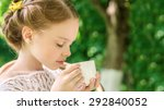 little girl with white cup... | Shutterstock . vector #292840052