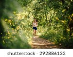 sporty woman running in the... | Shutterstock . vector #292886132
