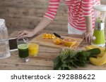 Small photo of Close-up of a young adult woman informing herself with a tablet PC about nutritional values of fruits and vegetables.