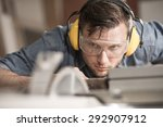 carpenter while using electric... | Shutterstock . vector #292907912
