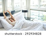 woman stretching in bed after... | Shutterstock . vector #292934828