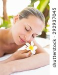 peaceful blonde lying on towel... | Shutterstock . vector #292937045