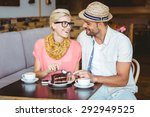 Cute Couple On A Date Eating A...