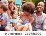 adults and kids sitting on the... | Shutterstock . vector #292956002