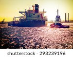 Tanker Ship With Tugboats On...
