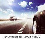 blurred car on icy road with sky | Shutterstock . vector #293574572
