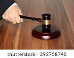 hand and hammer on table  law... | Shutterstock . vector #293758742