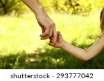 a the parent holding the hand... | Shutterstock . vector #293777042