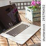 still life view of open laptop...   Shutterstock . vector #293790452