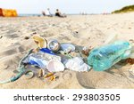 Garbage On A Beach Left By...