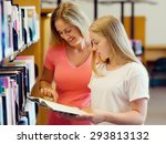 girl and her mother in library... | Shutterstock . vector #293813132