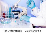 man is doing reseach with... | Shutterstock . vector #293914955