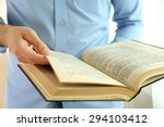 young man reading book close up | Shutterstock . vector #294103412