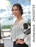 """Small photo of CANNES, FRANCE - MAY 20, 2015: Madalina Ghenea at the photocall for her movie """"Youth"""" at the 68th Festival de Cannes."""