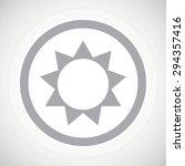 grey image of sun in circle  on ...