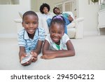 happy siblings lying on the... | Shutterstock . vector #294504212