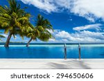 infinity pool with coco palms... | Shutterstock . vector #294650606